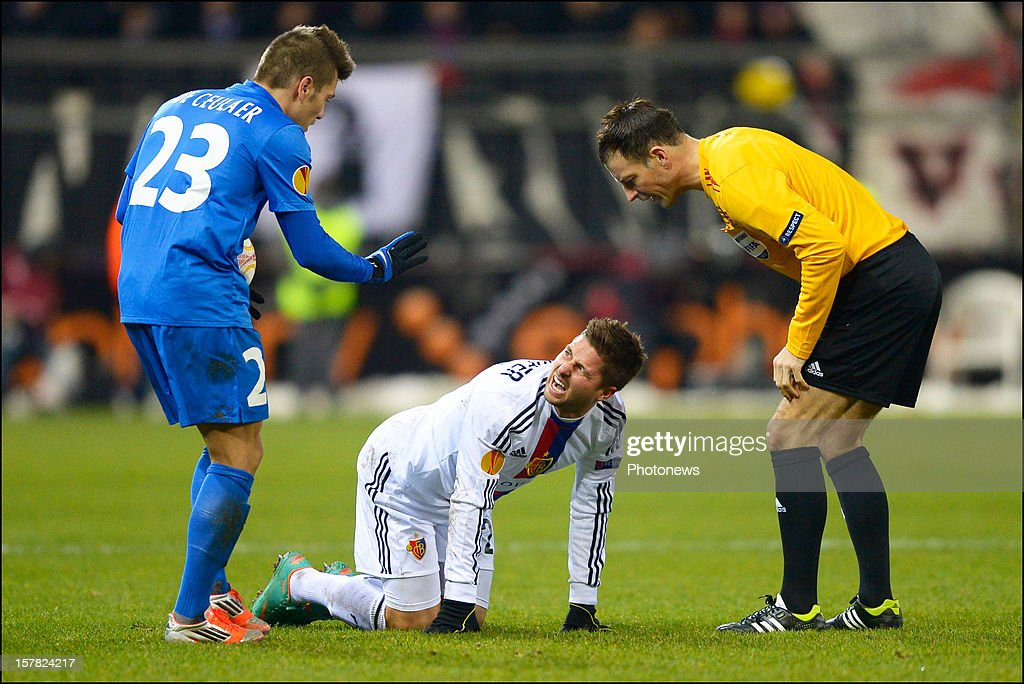 Benji De Ceulaer (L) of KRC Genk and Markus Steinhofer (C) of FC Basel 1893 argue in front of referee <a gi-track='captionPersonalityLinkClicked' href=/galleries/search?phrase=Mark+Clattenburg&family=editorial&specificpeople=2108870 ng-click='$event.stopPropagation()'>Mark Clattenburg</a> (R) during the UEFA Europa League group G match between KRC Genk and FC Basel 1893 at the Cristal Arena stadium on December 06, 2012 in Genk, Belgium.