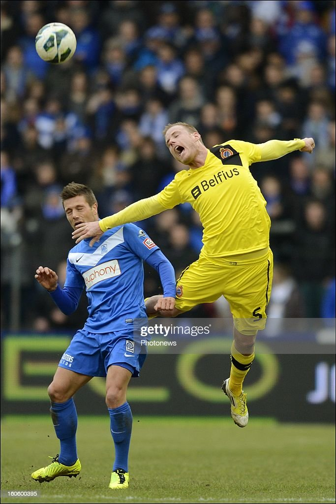 Benji De Ceulaer of KRC Genk battles for the ball with Frederik Stenman of Club Brugge KV during the Jupiler League match between KRC Genk and Club Brugge KV on February 3, 2013 in Genk, Belgium.