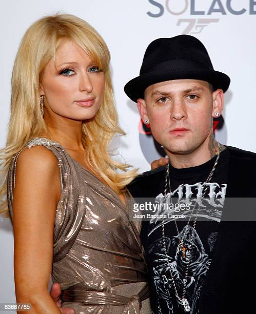 Benji Madden and Paris Hilton arrive at the prescreening of 'Bond 007 Quantum Of Solace' on November 13 2008 in Los Angeles California