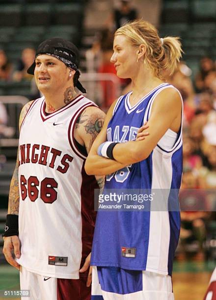 Benji Madden of Good Charlotte and actress Cameron Diaz during the NSYNC Challenge For The Children Celebrity Basketball Game at Office Depot Center...