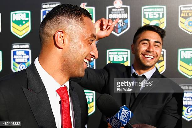 Benji Marshall and Shaun Johnson share a joke before the 2015 NRL season launch at Shed 10 on January 29 2015 in Auckland New Zealand