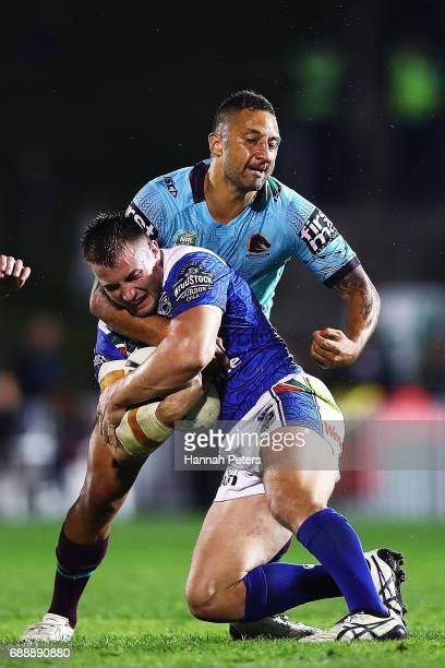 Benji Marshall of the Broncos tackles Kieran Foran of the Warriors during the round 12 NRL match between the New Zealand Warriors and the Brisbane...