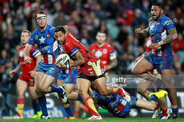 Benji Marshall of the Dragons breaks through a tackle to score a try during the round 21 NRL match between the Sydney Roosters and the St George...