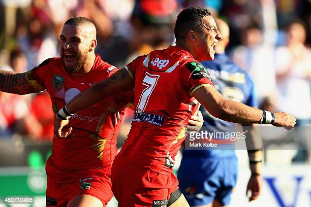 Benji Marshall of the Dragons celebrates scoring a try during the round 21 NRL match between the St George Illawarra Dragons and the Newcastle...