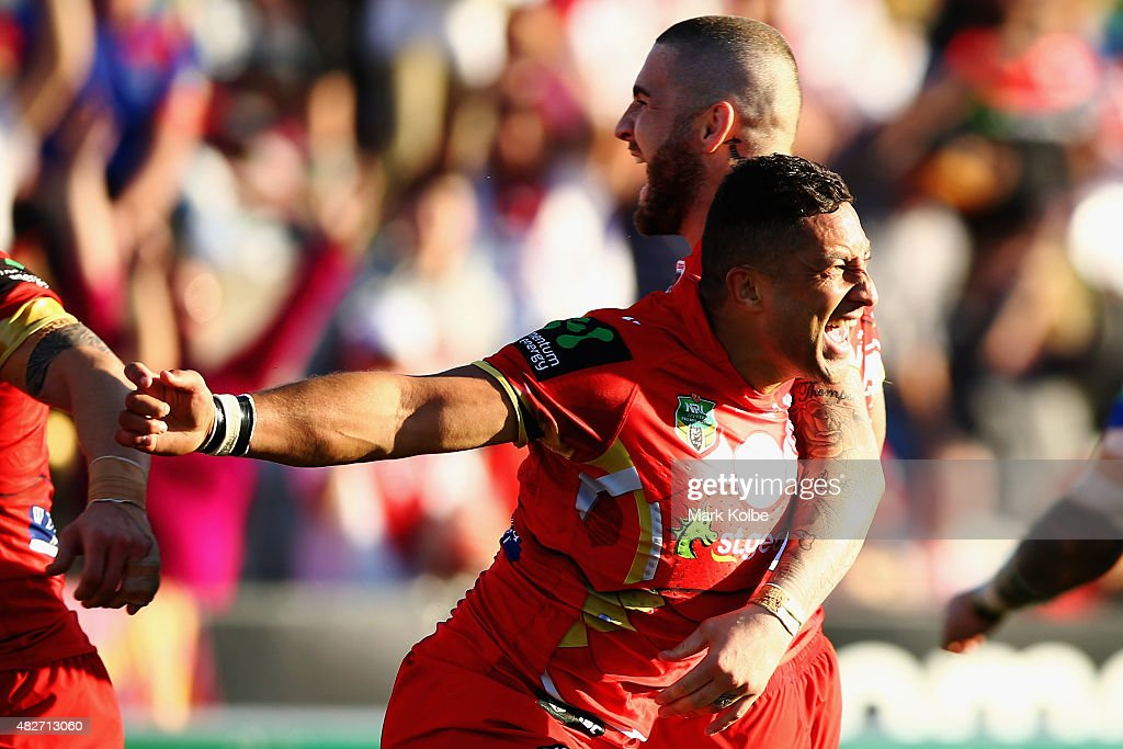 Benji Marshall of the Dragons celebrates scoring a try during the round 21 NRL match between the St George Illawarra Dragons and the Newcastle Knights at WIN Jubilee Stadium on August 2, 2015 in Sydney, Australia.