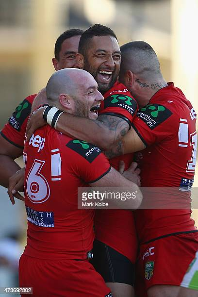Benji Marshall of the Dragons celebrates with his team mates after scoring a try during the round 10 NRL match between the St George Illawarra...