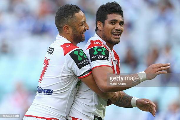 Benji Marshall of the Dragons congratulates Peter Mata'utia of the Dragons as he celebrates after scoring a try during the round six NRL match...