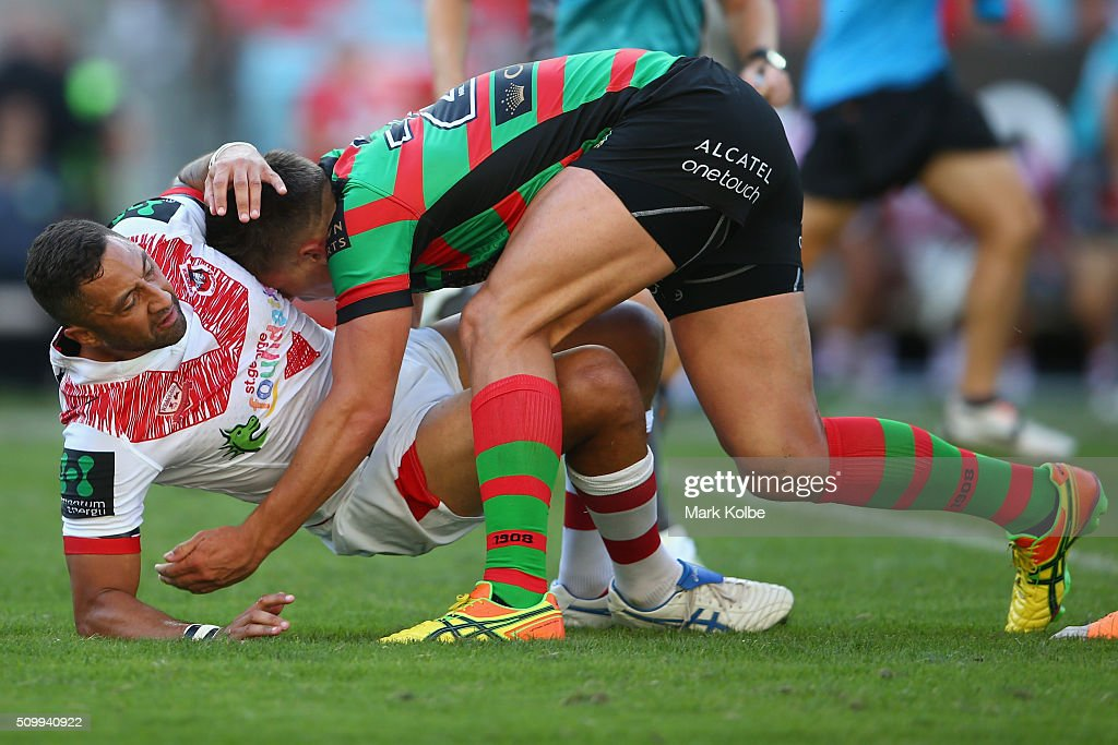 <a gi-track='captionPersonalityLinkClicked' href=/galleries/search?phrase=Benji+Marshall&family=editorial&specificpeople=215506 ng-click='$event.stopPropagation()'>Benji Marshall</a> of the Dragons is tackled by Jack Gosiewski after kicking during the NRL Charity Shield match between the St George Illawarra Dragons and the South Sydney Rabbitohs at ANZ Stadium on February 13, 2016 in Sydney, Australia.