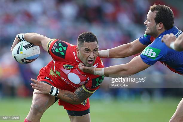 Benji Marshall of the Dragons is tackled high by Tyrone Roberts of the Knights during the round 21 NRL match between the St George Illawarra Dragons...