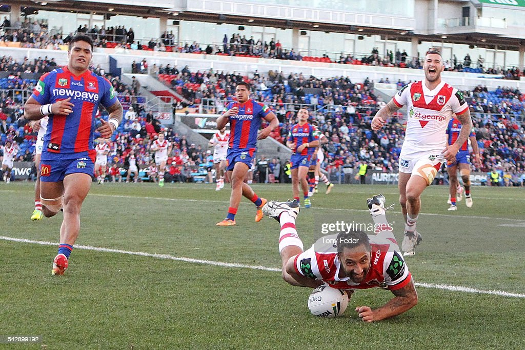 <a gi-track='captionPersonalityLinkClicked' href=/galleries/search?phrase=Benji+Marshall&family=editorial&specificpeople=215506 ng-click='$event.stopPropagation()'>Benji Marshall</a> of the Dragons scores a try during the round 16 NRL match between the Newcastle Knights and the St George Illawarra Dragons at Hunter Stadium on June 25, 2016 in Newcastle, Australia.
