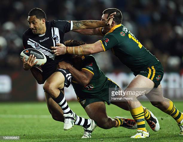 Benji Marshall of the Kiwis fends off Paul Gallen of the Kangaroos during the Four Nations match between the New Zealand Kiwis and the Australian...