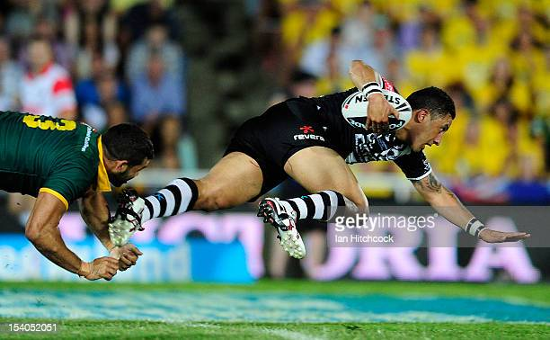 Benji Marshall of the Kiwis is tackled by Greg Inglis of the Kangaross during the International Test match between the Australian Kangaroos and the...