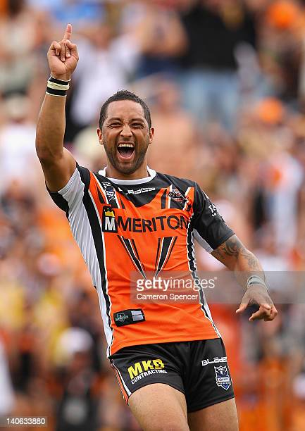 Benji Marshall of the Tigers celebrates kicking the winning dropgoal in extra time during the round one NRL match between the Wests Tigers and the...