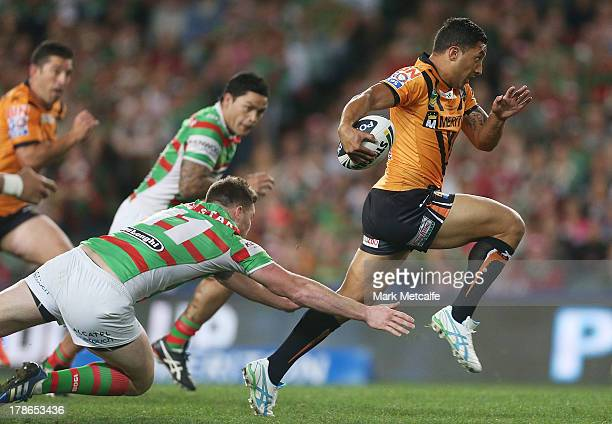 Benji Marshall of the Tigers makes a break during the round 25 NRL match between the Wests Tigers and the South Sydney Rabbitohs at Allianz Stadium...