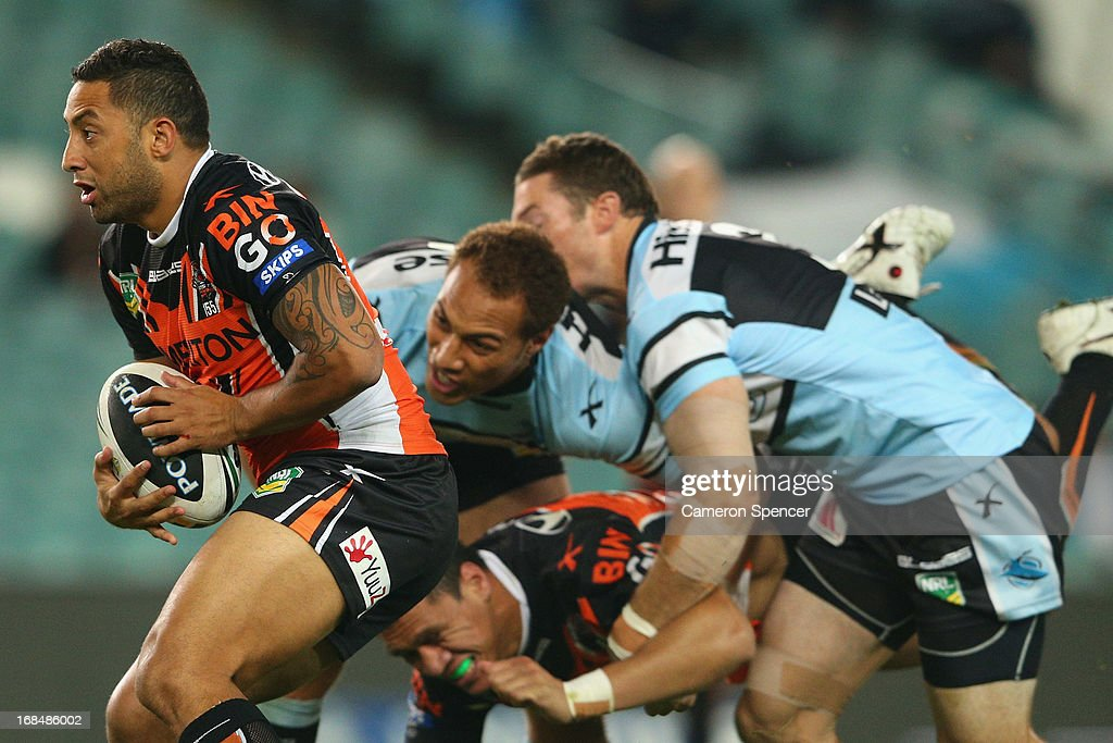 <a gi-track='captionPersonalityLinkClicked' href=/galleries/search?phrase=Benji+Marshall&family=editorial&specificpeople=215506 ng-click='$event.stopPropagation()'>Benji Marshall</a> of the Tigers makes a break during the round nine NRL match between the Wests Tigers and the Cronulla Sharks at Allianz Stadium on May 10, 2013 in Sydney, Australia.