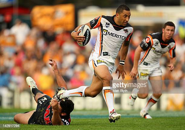 Benji Marshall of the Tigers makes a break during the round seven NRL match between the Penrith Panthers and the Wests Tigers at Centrebet Stadium on...