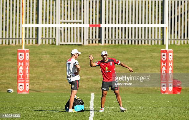 Benji Marshall talks with Ben Hornby during a St George Illawarra Dragons NRL training session at WIN Stadium on May 13 2014 in Wollongong Australia