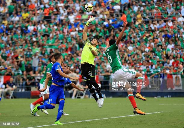 Benji Villalobos of El Salvador blocks a corner kick as Edison Alvarez of Mexico challengesduring the first half of a 2017 CONCACAF Gold Cup Group C...