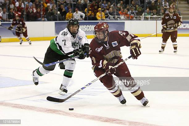 Benn Ferriero of Boston College advances the puck during 3rdperiod action against North Dakota in the semifinals of the NCAA frozen four at the...