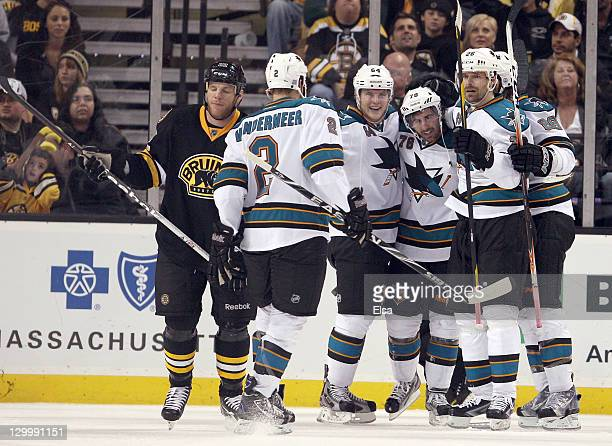 Benn Ferriero of the San Jose Sharks is congratulated by teammates Jim VandermeerJamie McGinn and Michal Handzus after Ferriero scored the game...