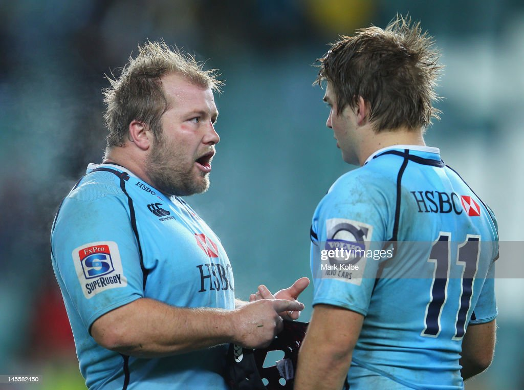 Benn Robinson and <a gi-track='captionPersonalityLinkClicked' href=/galleries/search?phrase=Drew+Mitchell&family=editorial&specificpeople=215065 ng-click='$event.stopPropagation()'>Drew Mitchell</a> of the Waratahs exchange words after losing the round 15 Super Rugby match between the Waratahs and the Hurricanes at Allianz Stadium on June 2, 2012 in Sydney, Australia.