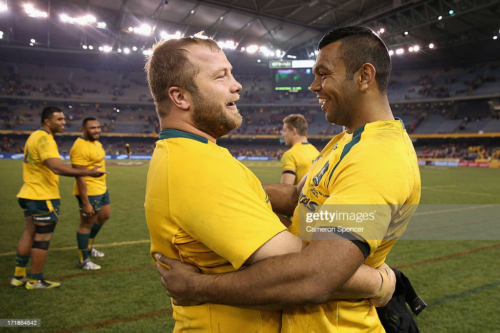 Benn Robinson of the Wallabies and <a gi-track='captionPersonalityLinkClicked' href=/galleries/search?phrase=Kurtley+Beale&family=editorial&specificpeople=3020818 ng-click='$event.stopPropagation()'>Kurtley Beale</a> of the Wallabies celebrate winning game two of the International Test Series between the Australian Wallabies and the British & Irish Lions at Etihad Stadium on June 29, 2013 in Melbourne, Australia.