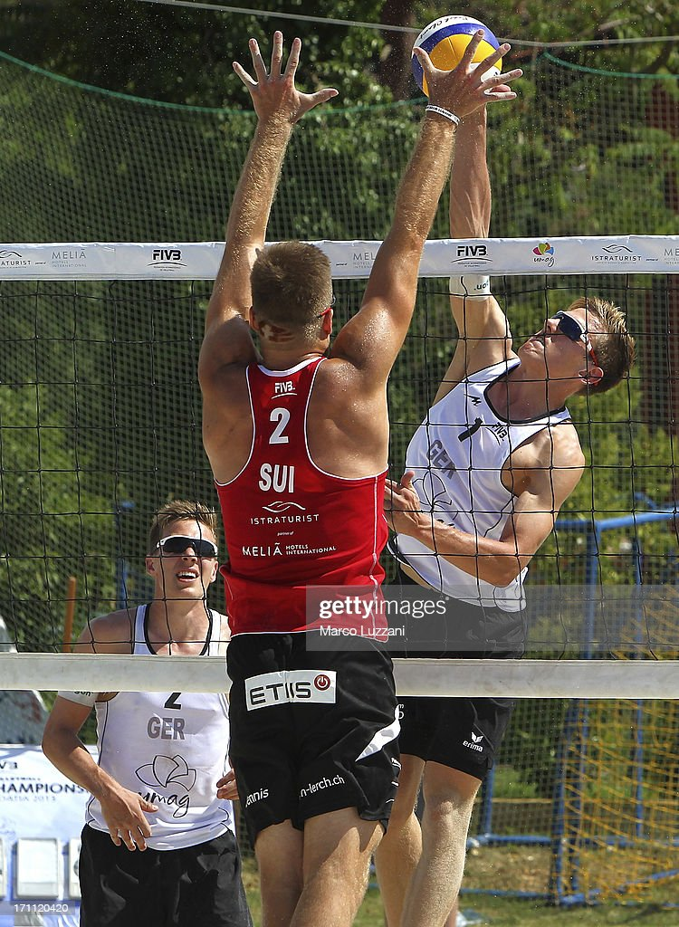 Bennet Poniewaz of Germany (R) in action against Dennis Lerch of Switzerland during FIVB Under 21 World Championships on June 22, 2013 in Umag, Croatia.