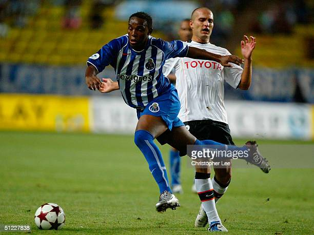 Benni McCarthy of FC Porto jumps a tackle from Ruben Baraja of Valencia during the UEFA Super Cup match between FC Porto and Valencia at the Stade...