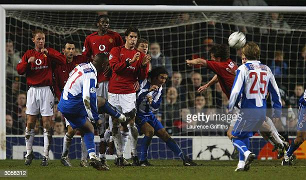 Benni McCarthy of FC Porto takes a free kick which leads to a goal from teammate Costinha during the UEFA Champions League match between Manchester...
