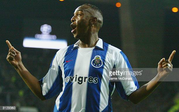 Benni McCarthy of Porto celebrates his goal during the UEFA Champions League Quarter FinalFirst Leg match between FC Porto and Lyon at The Estadio...