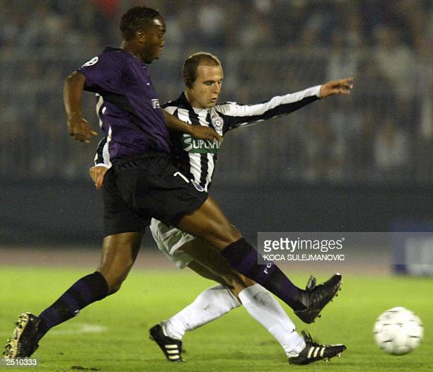 Benni McCarthy of Porto is challenged for the ball by Igor Duljaj of Partizan Belgrade during their UEFA Champions league first round group F soccer...