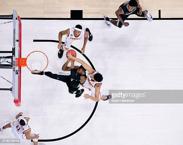 Bennie Boatwright of the USC Trojans blocks a shot by Kris Dunn of the Providence Friars during the first round of the NCAA Men's Basbetball...