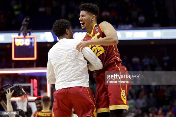 Bennie Boatwright of the USC Trojans celebrates with a teammate after defeating the Southern Methodist Mustangs during the first round of the 2017...