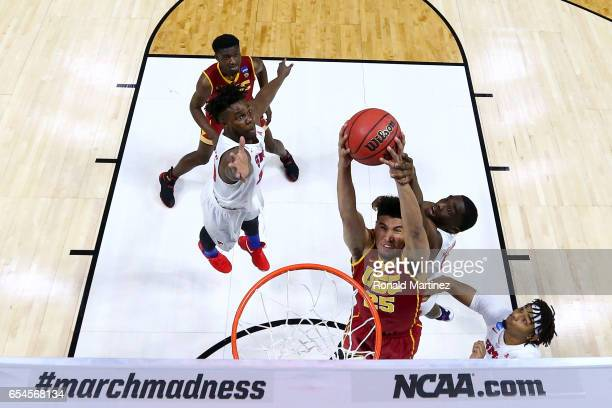 Bennie Boatwright of the USC Trojans goes up with the ball against Shake Milton of the Southern Methodist Mustangs in the first half during the first...