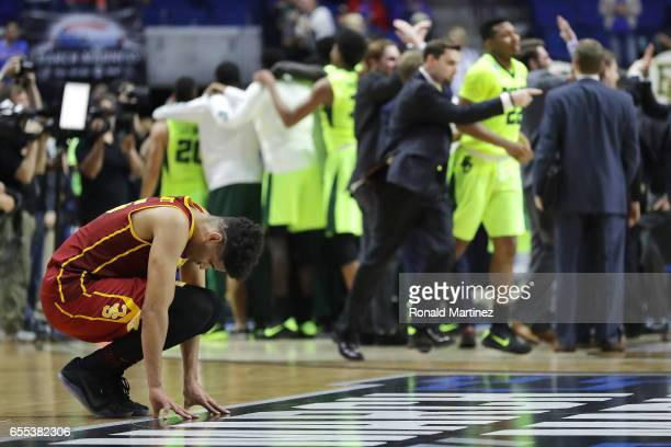 Bennie Boatwright of the USC Trojans reacts as the Baylor Bears celebrate their 8278 win over the USC Trojans during the second round of the 2017...