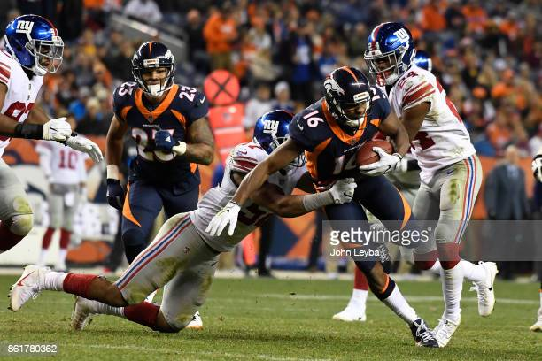 Bennie Fowler of the Denver Broncos is tackled by Keenan Robinson of the New York Giants in the fourth quarter The Denver Broncos hosted the New York...