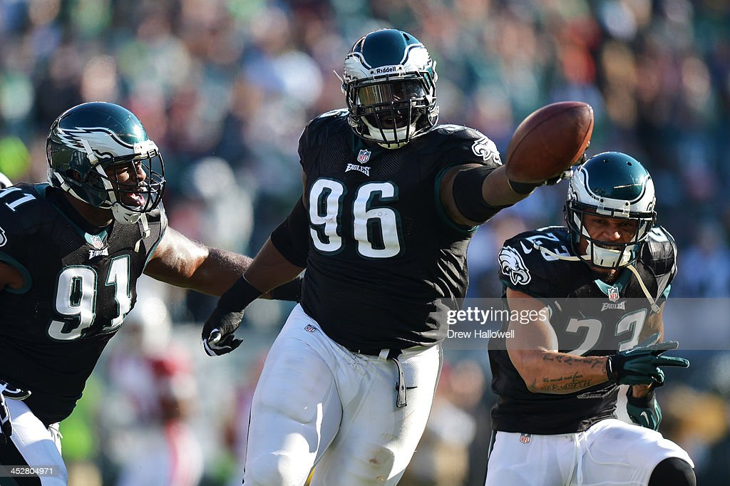 Bennie Logan #96 of the Philadelphia Eagles celebrates a fumble recovery with teammates Fletcher Cox #91 and Patrick Chung #23 against the Arizona Cardinals at Lincoln Financial Field on December 1, 2013 in Philadelphia, Pennsylvania. The Eagles won 24-21.