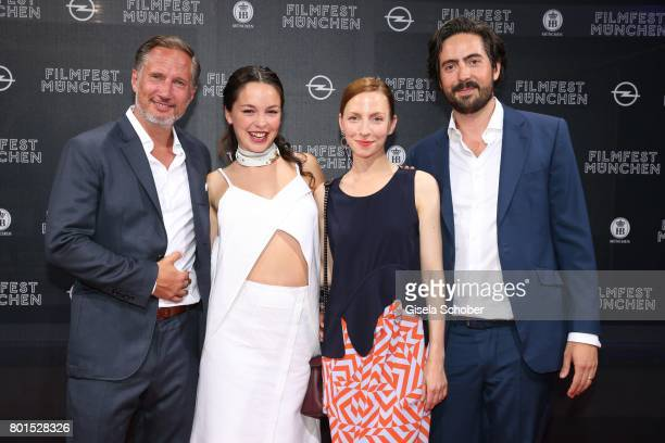 Benno Fuermann Tijan Marei Katharina Schuettler and Director David Dietl attend the premiere of the movie 'Ella's Baby' during the film festival...