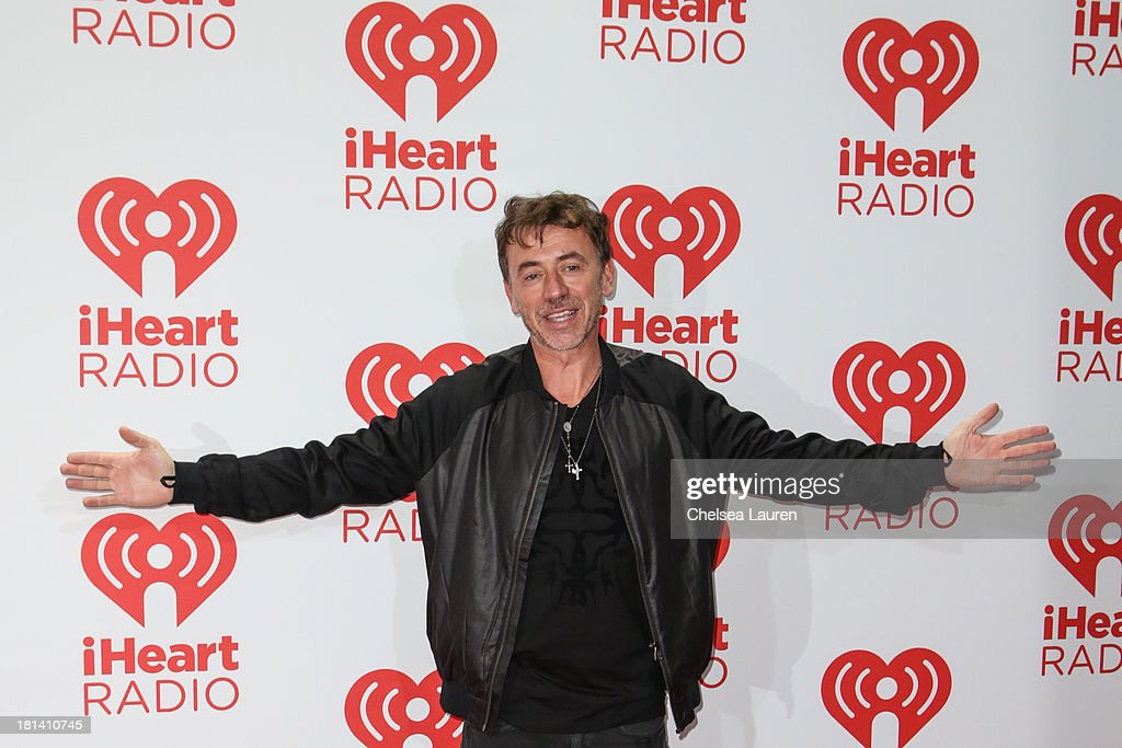 DJ Benny Benassi poses in the iHeartRadio music festival photo room on September 20, 2013 in Las Vegas, Nevada.