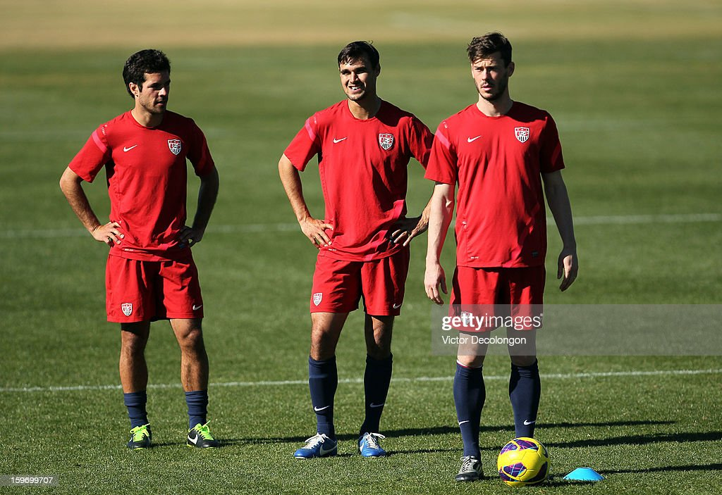 Benny Feilhaber, Chris Wondolowski and Brad Evans wait to do agility drills during the U.S. Men's Soccer Team training session at the Home Depot Center on January 17, 2013 in Carson, California.