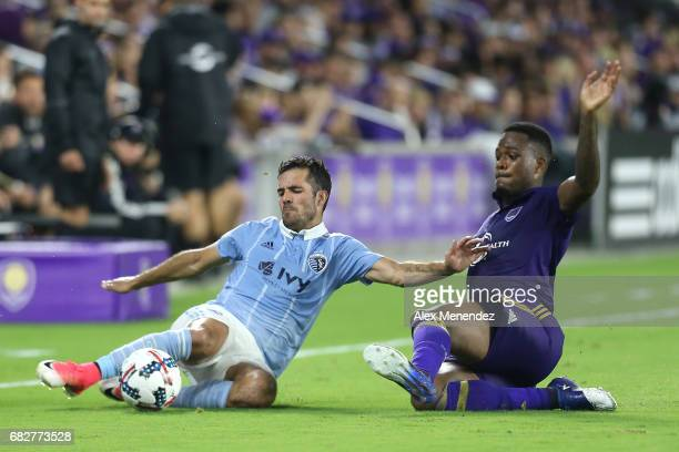 Benny Feilhaber of Sporting Kansas City defends the ball against Cyle Larin of Orlando City SC during an MLS soccer match between Sporting Kansas...