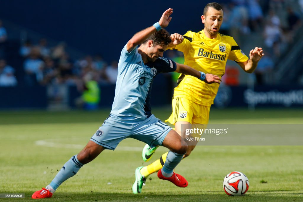 <a gi-track='captionPersonalityLinkClicked' href=/galleries/search?phrase=Benny+Feilhaber&family=editorial&specificpeople=737043 ng-click='$event.stopPropagation()'>Benny Feilhaber</a> #10 of Sporting KC changes direction and moves past Justin Meram #9 of Columbus Crew May 4, 2014 at Sporting Park in Kansas City, Kansas.