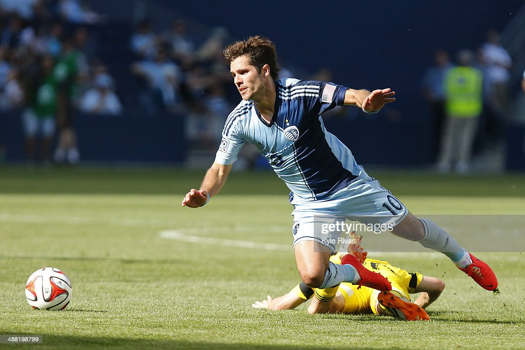 <a gi-track='captionPersonalityLinkClicked' href=/galleries/search?phrase=Benny+Feilhaber&family=editorial&specificpeople=737043 ng-click='$event.stopPropagation()'>Benny Feilhaber</a> #10 of Sporting KC is tripped by Ethan Finlay #13 of Columbus Crew midway in the second half May 4, 2014 at Sporting Park in Kansas City, Kansas.