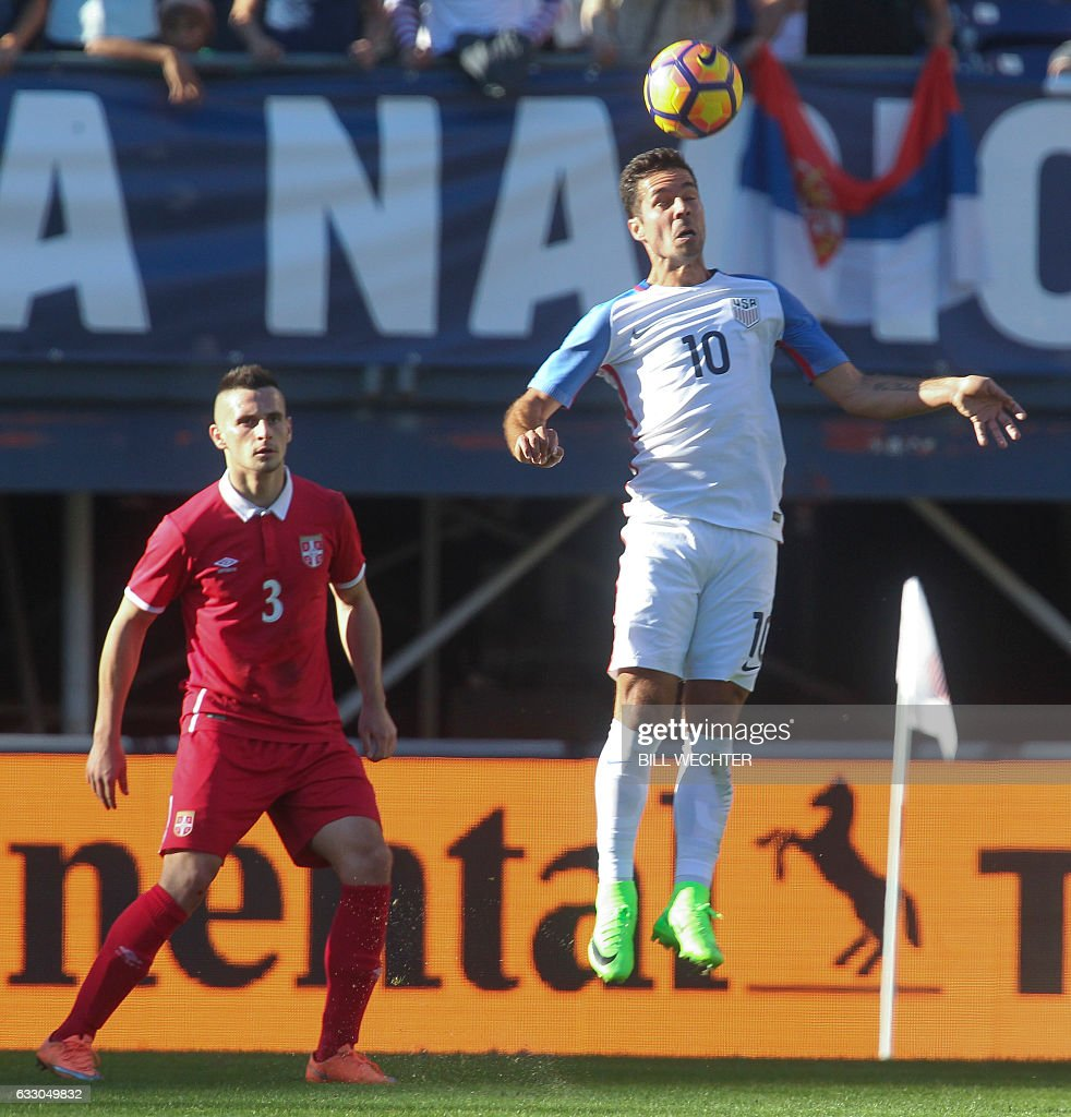 Benny Feilhaber of the US goes up for a header as Serbia's Nemanja Miletic looks on during the second half of a MLS friendly match at Qualcomm Stadium in San Diego, California on January 29, 2017. / AFP / Bill Wechter