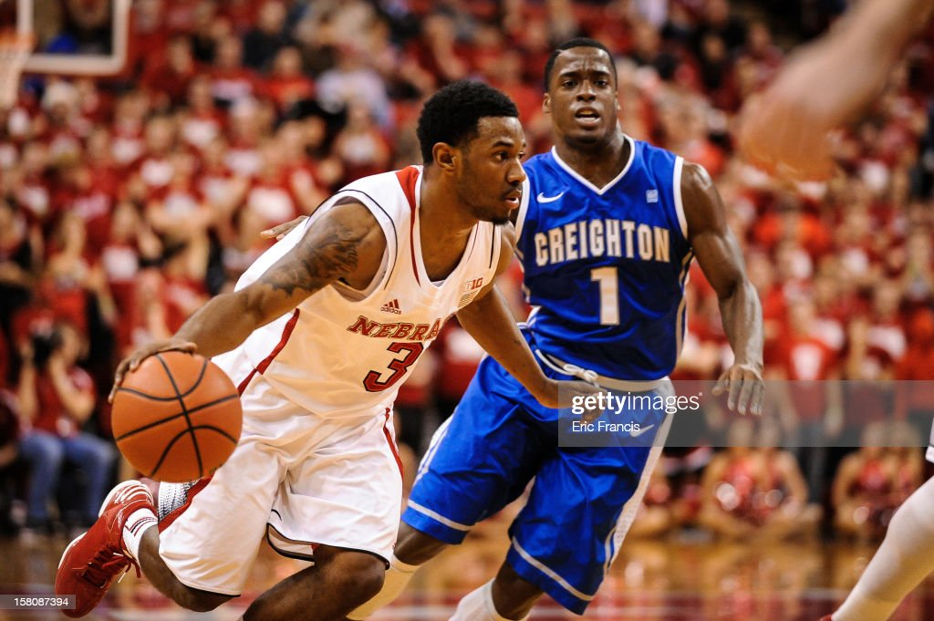 Benny Parker #3 of the Nebraska Cornhuskers drives around Austin Chatman #1 of the Creighton Bluejays during their game at the Devaney Center on December 6, 2012 in Lincoln, Nebraska.
