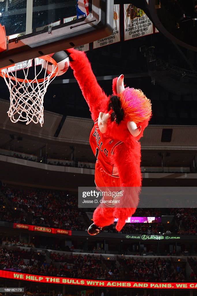 Benny the Bull of the Chicago Bulls dunks during halftime in the game against the Miami Heat in Game Four of the Eastern Conference Semifinals during the 2013 NBA Playoffs on May 13, 2013 at United Center in Chicago, Illinois.
