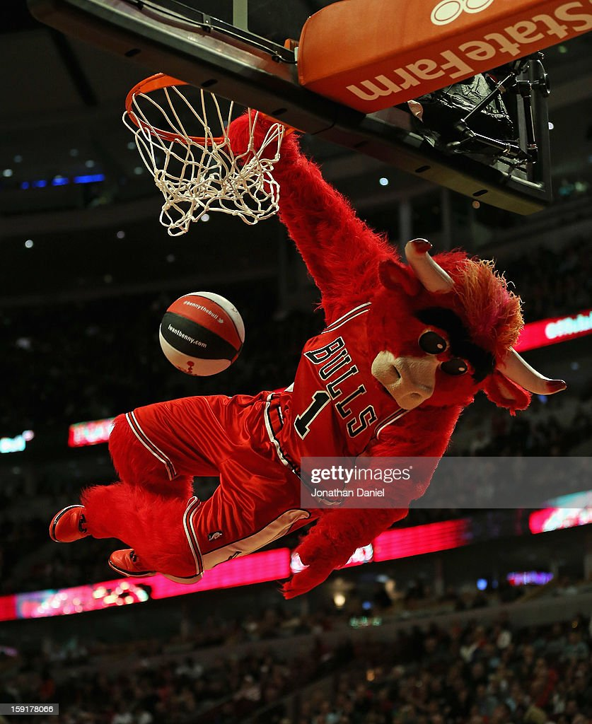 Benny, the mascot of the Chicago Bulls, dunks a ball during a break in the action between the Bulls and the New York Knicks at the United Center on December 8, 2012 in Chicago, Illinois. The Bulls defeated the Knicks 93-85.