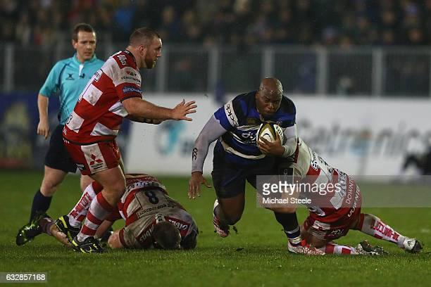 Beno Obano of Bath is tackled by Callum Braley of Gloucester as Yann Thomas closes in during the Anglo Welsh Cup match between Bath Rugby and...