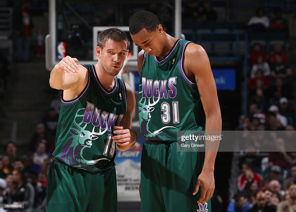 Beno Udrih #19 and John Henson #31 of the Milwaukee Bucks speak on court during the game against the Orlando Magic on February 2, 2013 at the BMO Harris Bradley Center in Milwaukee, Wisconsin.
