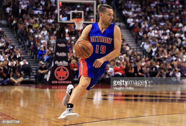 Beno Udrih of the Detroit Pistons dribbles the ball during an NBA game against the Toronto Raptors at Air Canada Centre on October 26 2016 in Toronto...